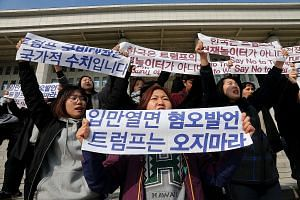 Demonstrators at a rally in Seoul yesterday to protest against US President Donald Trump's upcoming visit to South Korea.