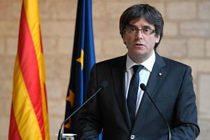 Catalan president Carles Puigdemont making a statement at the Generalitat (Catalan government headquarters) in Barcelona on Oct 26, 2017.
