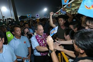 Above: Mr Low Thia Khiang meeting supporters after the Workers' Party rally for East Coast GRC in Bedok Stadium on Sept 9, 2015. Below: Mr Low speaking to Ms Sylvia Lim at a WP rally in Hougang during General Election 2006, with East Coast GRC candid