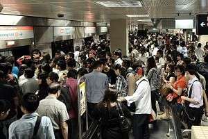 Left: Commuters at Bishan MRT station waiting for trains on Dec 15, 2011, after a massive breakdown of services on the North-South Line. Above: Last month's heavy flooding in MRT tunnels had emergency responders from the Singapore Civil Defence Force