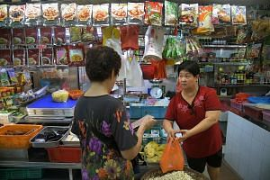 Madam Tay Geok Hua attending to a customer. She has run the stall with her husband for about 40 years and plans to retire in a couple of years now that her children have jobs of their own.