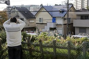 "Left: The ""house of horrors"" (centre) in Zama where Takahiro Shiraishi (above) killed his nine victims."