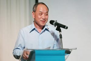 Low Thia Khiang speaks during the Workers' Party 60th anniversary dinner.