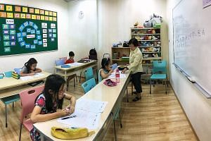 A Primary 3 Chinese class at Han Language Centre in Eastpoint Mall last Wednesday. With SPH's acquisition of a 75 per cent stake in the Chinese education brand fully completed, it now has more resources to expand its range of programmes. Its staff st