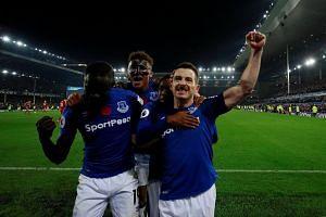 Everton's Leighton Baines celebrates scoring their third goal with Dominic Calvert-Lewin (centre) and Oumar Niasse (left).