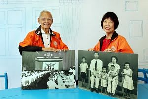 Mr Siregar Johnnie (John) and Ms Boo Hong Kwen with photos of their younger selves. The senior guides will share stories about their youth as part of the Dialogue With Time exhibition, using their photos as visual aids.