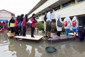 Exams go on in flood-hit Penang: It would have been the perfect excuse to skip school, but the floods in Penang did not deter these students from heading to SMK Datuk Haji Ahmad Said in Sungai Dua, Butterworth, yesterday to sit their Sijil Pelajaran