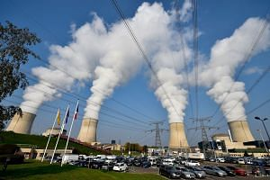 Steam rising from the chimneys of the nuclear power plant at Cattenom in eastern France. The French government is postponing a target to reduce the share of nuclear energy in the country, Environment Minister Nicolas Hulot said on Nov 7, 2017.