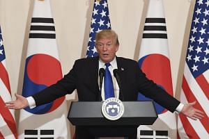 US President Donald Trump speaking during a press conference at the presidential office in Seoul on Nov 7, 2017.