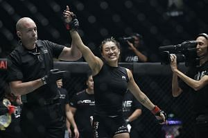 Left: Atomweight world champion Angela Lee retaining her title against Brazilian Istela Nunes during their bout in May this year. The MMA fighter will take her time to recover from her car accident and will not fight in another title defence against