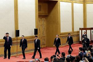 China's new Politburo Standing Committee members, (from left) Mr Xi Jinping, Mr Li Keqiang, Mr Li Zhanshu, Mr Wang Yang, Mr Wang Huning, Mr Zhao Leji and Mr Han Zheng arriving to meet with the press at the Great Hall of the People in Beijing on Oct 2