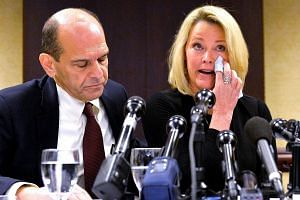 Former Boston news anchor Heather Unruh sits with her attorney Mitchell Garabedian at a press conference in Boston on Nov 8, 2017.