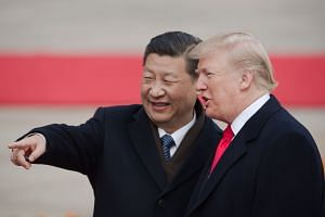 China's President Xi Jinping (left) and US President Donald Trump attend a welcome ceremony at the Great Hall of the People in Beijing on Nov 9, 2017.
