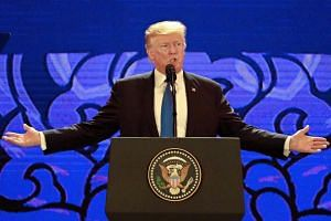 US President Donald Trump speaks on the final day of the APEC CEO Summit, part of the broader Asia-Pacific Economic Cooperation (APEC) leaders' summit, in the central Vietnamese city of Danang on Nov 10, 2017.