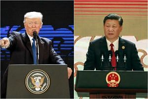 While US President Donald Trump (left) and Chinese President Xi Jinping spoke, a much-anticipated agreement to take the Trans-Pacific Partnership trade deal forward did not materialise after a no-show by Canada led to the postponement of a scheduled