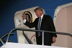 US President Donald Trump arrives aboard Air Force One at Ninoy-Aquino International Airport in Manila on Nov 12, 2017.