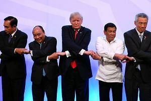 """US President Donald Trump (centre) had told a gathering of Pacific Rim leaders the US would no longer tolerate """"chronic trade abuses"""" from the region."""