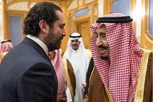 King Salman bin Abdulaziz al-Saud (right) shaking hands with former Lebanese prime minister Saad Hariri in the capital Riyadh.