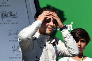 Williams' Brazilian driver Felipe Massa reacts as he bids farewell to the crowd after his final home city race at the end of the Brazilian Formula One Grand Prix, at the Interlagos circuit in Sao Paulo, Brazil, on Nov 12, 2017.