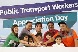 Transport Minister Khaw Boon Wan with representatives from the public transport operators - (from left) Ms Gena Goh (Tower Transit Singapore), Mr Lim Yew Huat (SBS Transit), Mr Charnjit Singh (SMRT) and Mr Muhammad Azan Jamalludin (Go-Ahead Singapore