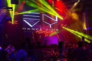 The police have arrested five men who were seen in a video shouting gang-related slogans during a fight at Envy Dance Club (pictured).