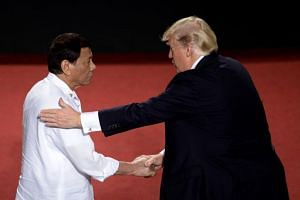 Philippine President Rodrigo Duterte shakes hands with US President Donald Trump during the 31st Association of Southeast Asian Nations (ASEAN) Summit in Cultural Center of the Philippines (CCP) in Manila on Nov 13, 2017.