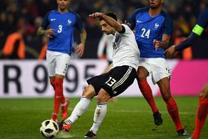 Germany's striker Lars Stindl scores the 2-2 goal.