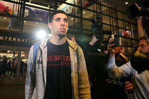 UCLA basketball player LiAngelo Ball arrives home from China, where he was detained on suspicion of shoplifting.