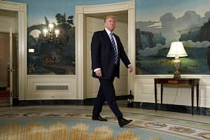 Trump arrives to speak about his recent trip to Asia in the Diplomatic Room of the White House.