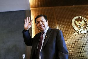 Indonesian Parliament Speaker Setya Novanto waves shortly after a press conference at the parliament building in Jakarta.