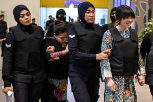 Vietnamese Doan Thi Huong (right) and Indonesian Siti Aishah (second from left) have been charged with the murder of Kim Jong Nam.