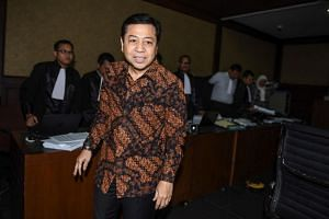 Indonesia's Speaker of the House Setya Novanto leaves a courtroom after appearing as a witness in an embezzlement case involving electronic identity cards in Jakarta.