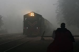 A train leaving a railway station amid heavy smog in Lahore, Pakistan.
