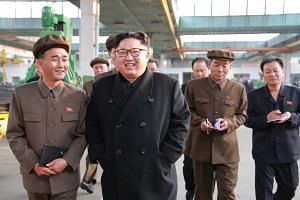 North Korean leader Kim Jong Un visits a factory in an undated picture released on Nov 4, 2017.