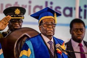 Zimbabwe's President Robert Mugabe delivers a speech during a graduation ceremony at the Zimbabwe Open University in Harare, where he presides as the Chancellor on Nov 17,  2017.
