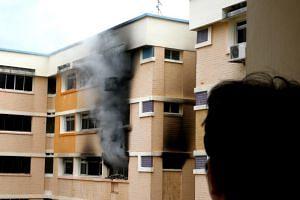 File photo of thick smoke billowing from a HDB flat.