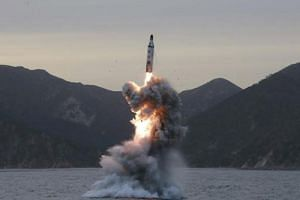 An undated photo released by North Korean Central News Agency (KCNA) shows an 'underwater test-fire of strategic submarine ballistic missile' conducted at an undisclosed location in North Korea.