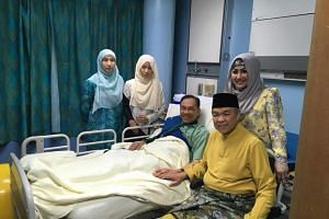 In the picture, Mr Zahid and his wife Datin Seri Hamidah Khamis were seen by Anwar bedside. Two of Anwar's daughters were also in the room.