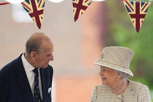 Britain's Queen Elizabeth and Prince Philip visit Pangbourne College near Reading, on May 9, 2017.
