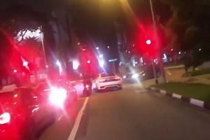 Maserati driver Lee Cheng Yan allegedly drove into the officer who was left clinging to the driver's door.