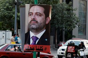 A poster depicting Saad al-Hariri, who announced his resignation as Lebanon's prime minister from Saudi Arabia, is seen in Beirut, Lebanon on Nov 17, 2017.