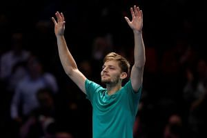 Goffin celebrates after winning his semi final match against Switzerland's Roger Federer.