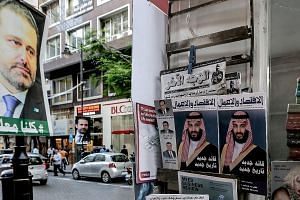 Posters supporting Mr Saad al-Hariri, who resigned as Lebanon's Prime Minister, seen with magazine covers featuring Saudi Arabia's Crown Prince Mohammed bin Salman in Beirut last week. Militia outfit Hizbollah's growing power may be a reason behind t