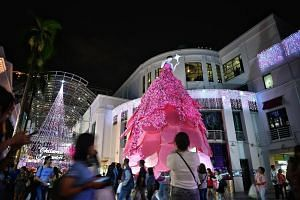 Christmas decorations at Bugis Junction. Several mall managers and retail experts say the positive outlook for the retail industry is translating into more decorations being put up for Christmas this year. City Square Mall (left) is taking it up a no