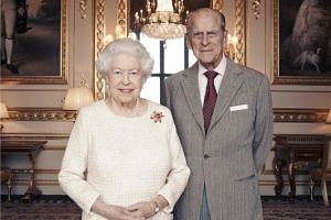 Queen Elizabeth and Prince Philip in the official photo marking their 70th wedding anniversary.