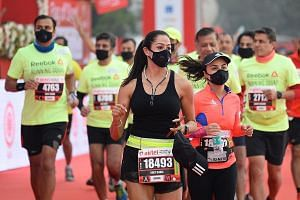 Participants donning face masks as they ran in the Delhi half-marathon yesterday despite pollution levels reaching nearly nine times the World Health Organisation's safe maximum.