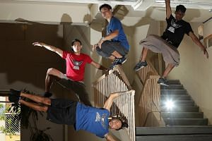 Parkour enthusiasts from local academy Superfly Monkey Dragons (clockwise from bottom left): Mr Daniel Rojas, 41, Mr Michael De Leon, 31, Dr Derrick Siu, 44, and Mr Tareesh Ismail, 19.