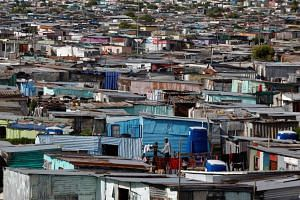 """""""The pace of scale-up has been particularly remarkable in eastern and southern Africa, the region most affected by the epidemic,"""" said the """"Right to Health"""" report, released in Khayelitsha township, some 30km from Cape Town."""