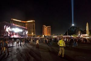 People at the Route 91 Harvest festival, with the Mandalay Bay Hotel behind the stage, on Las Vegas Boulevard South in Las Vegas, Nevada, US on Sept 30, 2017.