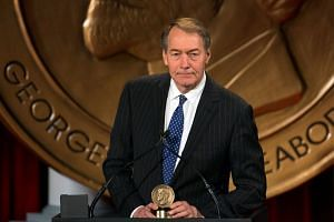 A file photo of Charlie Rose receiving the Peabody Award for his work in One On One With Assad, on May 19, 2014.